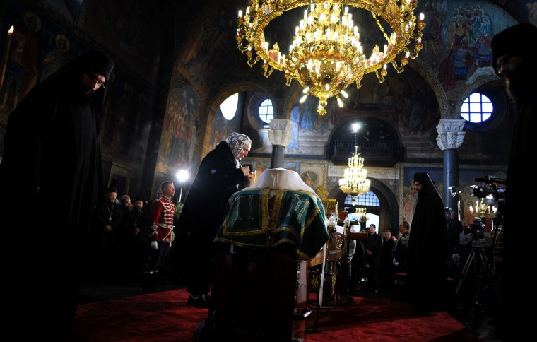 A woman pays her respects in front of the coffin of the late Patriarch Maxim of Bulgaria's Orthodox Church during a memorial ceremony in St. Nedelia cathedral in Sofia on November 8, 2012. Patriarch Maxim, Bulgaria's religious leader for over 40 years and the longest-serving Orthodox Christian leader in Europe, died early on November 6, 2012 the Holy Synod announced. He was 98, (Nikolay Doychinov/Getty Images)