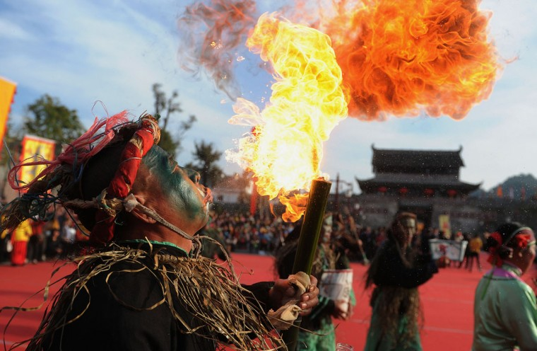 An artist performs during the opening ceremony of an old town during the first Intangible Cultural Heritage Exhibition of Chinese Traditional Art held in Huangshan, central China's Anhui province on November 7, 2012. China will set up a system to eliminate poorly-managed intangible cultural heritage, according to a notice issued by the Ministry of Culture on September 6. (STR/AFP/Getty Images)