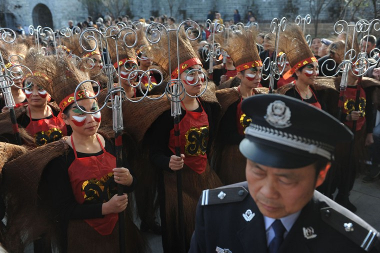 Artists wait to perform during the opening ceremony of an old town during the first Intangible Cultural Heritage Exhibition of Chinese Traditional Art held in Huangshan, central China's Anhui province on November 7, 2012. (STR/AFP/Getty Images)