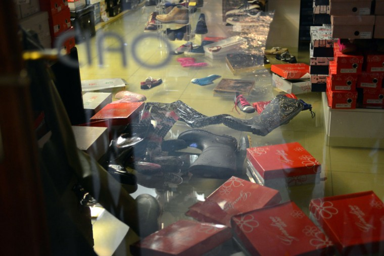 "Rain boots and other shoes float in a flooded shop during an ""acqua alta"" on Nov. 11, 2012, in Venice. Rain and wind struck the north of Italy, with flooding reaching 150 centimeters, or about 59 inches, in Venice. (Marco Sabadin/AFP/Getty Images)"