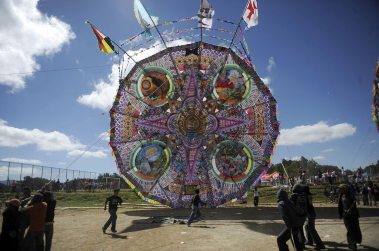 Men lift up a giant kite to the sky to celebrate Kites Day, in honor to the New Maya Era next December 21, in Guatemala City on November 11, 2 012. (Johan Ordonez/AFP/Getty Images)