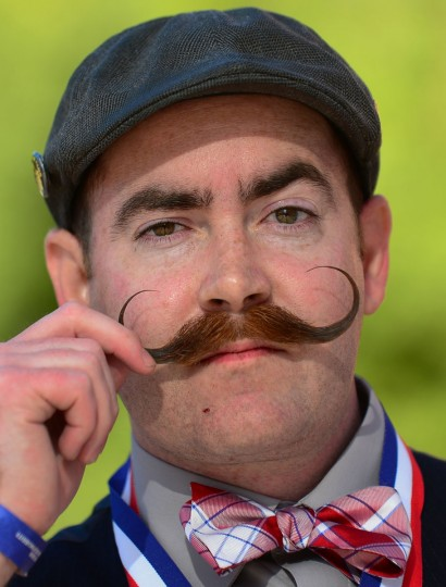Steve McQuaide from Burbank, California, poses after winning first place in the Imperial Moustache category at the third annual National Beard and Moustache Championships in Las Vegas, Nevada on November 11, 2012. (Frederic J. BrownAFP/Getty Images)