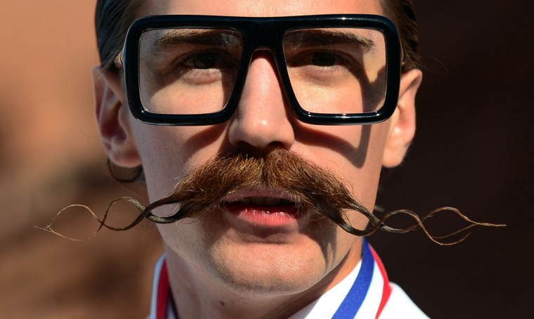 Daniel Lawlor from Los Angeles, California, poses after winning first place in the Freestyle Moustache category at the third annual National Beard and Moustache Championships in Las Vegas, Nevada on November 11, 2012. (Frederic J. BrownAFP/Getty Images)