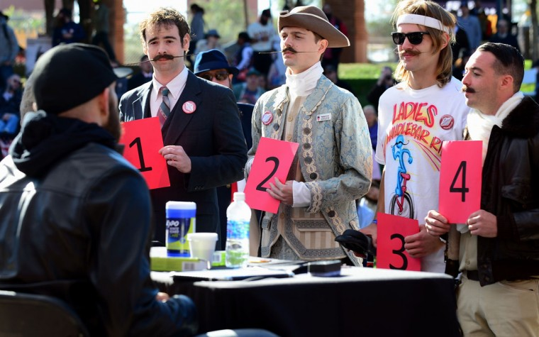 Contestants with their moustaches face the judges at the third annual National Beard and Moustache Championships in Las Vegas, Nevada on November 11, 2012, won by Patrick Fette (#2) from Louisville, Kentucky, in the English Moustache category. (Frederic J. BrownAFP/Getty Images)