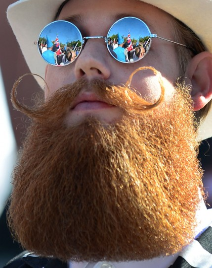 The crowd is reflected in the glasses of a bearded competitor at the third annual National Beard and Moustache Championships in Las Vegas, Nevada on November 11, 2012. (Frederic J. BrownAFP/Getty Images)