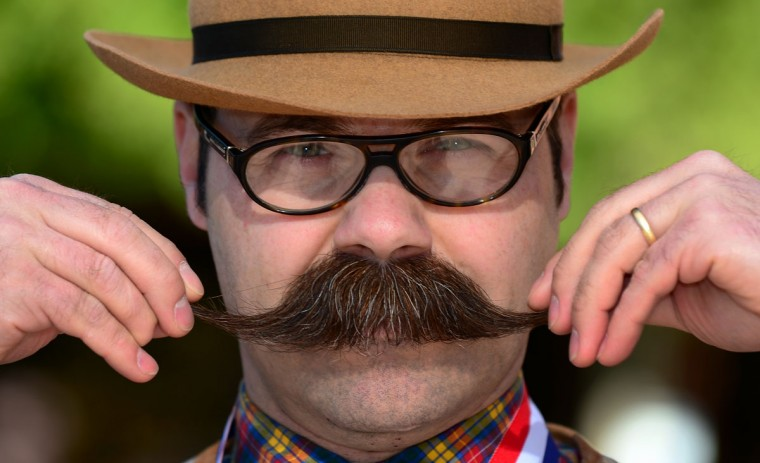 Adam Orcutt from Michigan City, Indiana, poses after winning first place in the Natural Moustache category at the third annual National Beard and Moustache Championships in Las Vegas, Nevada on November 11, 2012. (Frederic J. BrownAFP/Getty Images)