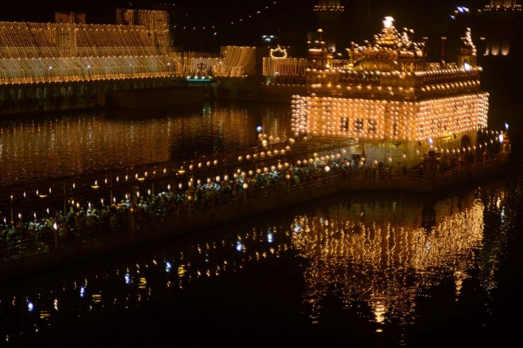 Indian Sikh devotees pay their respects at the illuminated Sikhism's holiest shrine Golden Temple in Amritsar on November 12, 2012, on the eve of Bandi Chhor Divas or Diwali. (Narinder Nanu/AFP/Getty Images)