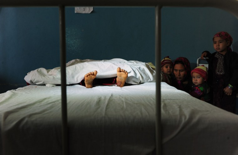 The family of a five-year-old Afghan girl, that was allegedly raped by a 22-year-old man, looks on as she lies in a hospital bed in Kaldar district of Balk Province of Mazar-i-Sharif on November 12, 2012. The alleged rapist and neighbor was later detained by police. Some 87 percent of Afghan women report having experienced physical, sexual or psychological violence or forced marriage, according to figures quoted in an October report by the British charity Oxfam. (Qais Usyan/AFP/Getty Images)