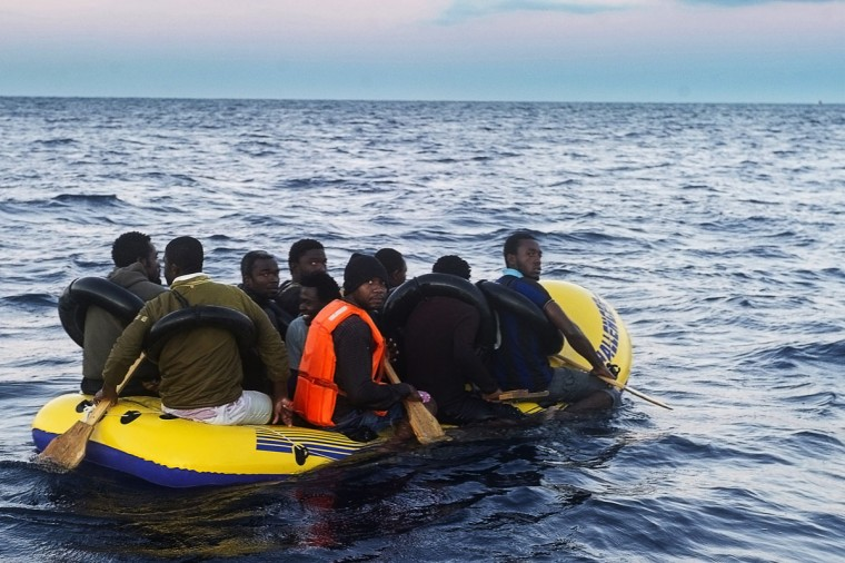 Would-be immigrants row in an inflatable boat off the Spanish coast, six miles (9.65 kilometers) from Tarifa. Spanish emergency services and the Red Cross intercepted the boat carrying 10 sub-Saharan would-be immigrants off the Spanish coast, near Tarifa (southern Spain), as the country faces several weeks to an influx of illegal immigrants trying to cross the Strait of Gibraltar. (Marcos Moreno/AFP/Getty Images)