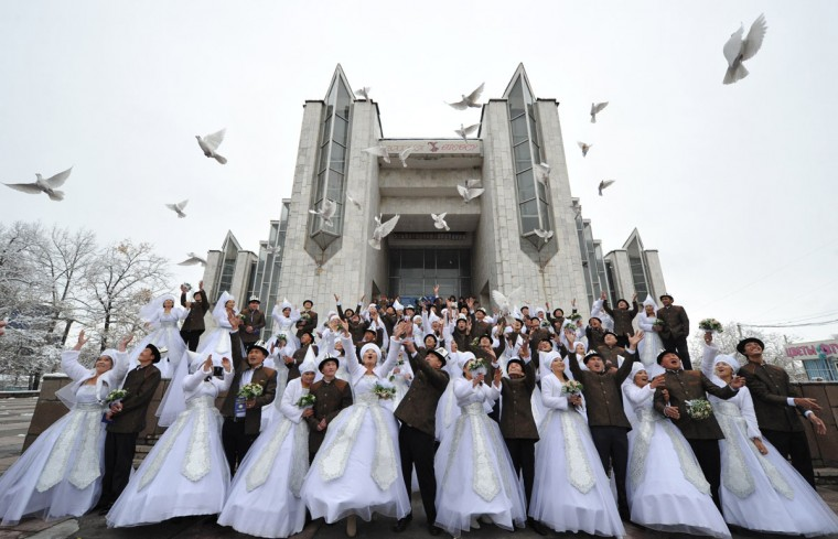 Kyrgyz couples take part in a mass wedding ceremony in the capital Bishkek. Thirty-five couples took part in the mass wedding sponsored by a state company. (Vyacheslav Oseledko/AFP/Getty Images)