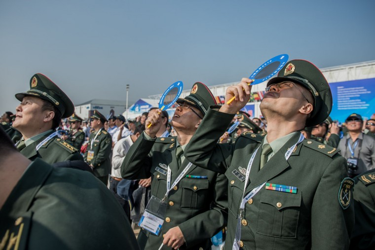 Officers of China's People Liberation Army (PLA) watch planes performing during the 9th China International Aviation and Aerospace Exhibition in Zhuhai. China's air show comes as the Communist Party holds a meeting to select the country's new leaders -- including the party's Central Military Commission, which controls the armed forces. (Philippe Lopez/AFP/Getty Images)