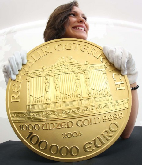 "A woman presents Europe's biggest gold coin during an exhibition at the Pro Aurum trade house in Hamburg, northern Germany. The so-called ""Big Phil"" made after the model of an Austrian coin weighs around 31 kilograms and is worth more than 1.3 million euros or 1.7 million US dollars. ""Big Phil"" is on display at Pro Aurum until November 17, 2012.  (Christian Charisius/Getty Images)"