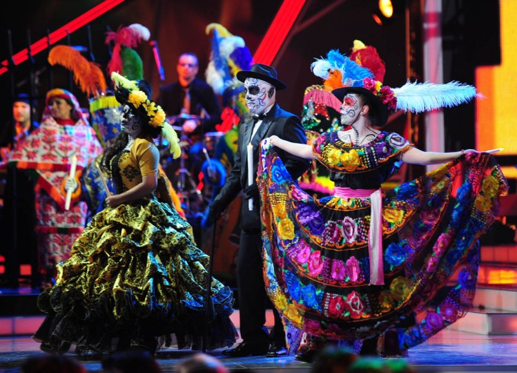 Cast members perform with singer Lila Downs and Celso Pina (not in frame) during the 13th Annual Latin Grammy show in Las Vegas, Nevada. (Robyn Beck/AFP/Getty Images)