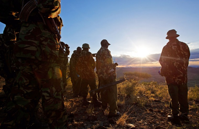 Kenyan Police officers look over the valley on November 15, 2012 where the mass killings of police took place in Samburu north district near Baragoi. Some of the remaining four bodies where found close to where the ambush took place by alleged Turkana cattle rustlers. (Ivan Lieman/AFP/Getty Images)