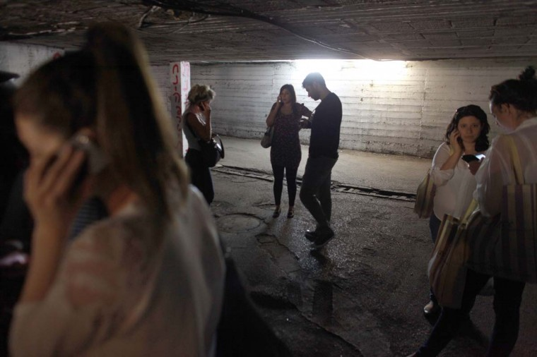 NOVEMBER 16 — Israelis take cover in a bomb shelter in central Tel Aviv as sirens wail on November 16, 2012. (Daniel Bar-On/AFP/Getty Images)