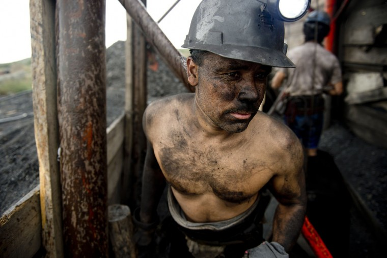 A Mexican miner emerges from a shaft in a coal mine in Agujita, Coahuila State in Mexico on November 13, 2012. According to the Mining Chamber of Mexico, the country produces annually 15 million tons of coal, with an average annual production worth USD 3,800 million, representing 1.6% of the country's Gross Domestic Product (GDP). (Yuri Cortez/AFP/Getty Images)