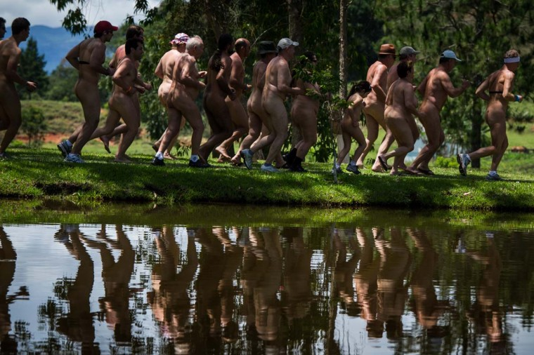 Naturists run the 3 km Marathon during the first Brazilian Naturist Olympics in Guaratingueta, about 200 km east of Sao Paulo, Brazil on Novemeber 18, 2012. For 3 days, around 60 members of the Brazilian Federation of Naturism have competed in 30 disciplines. (Yasuyoshi Chibaya/AFP/Getty Images)