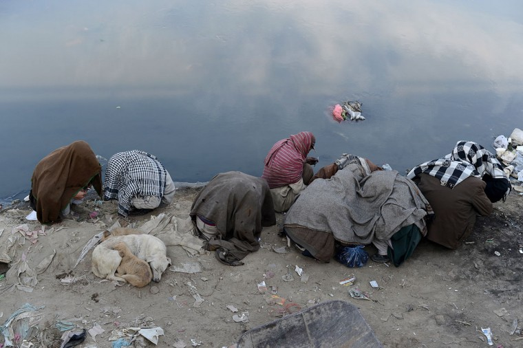 Afghan men take drugs alongside the Kabul river in Kabul. Afghan officials and experts cite a figure of 60,000 drug users in the capital city of Kabul which has an estimated total population of five million. (Shah Marai/AFP/Getty Images