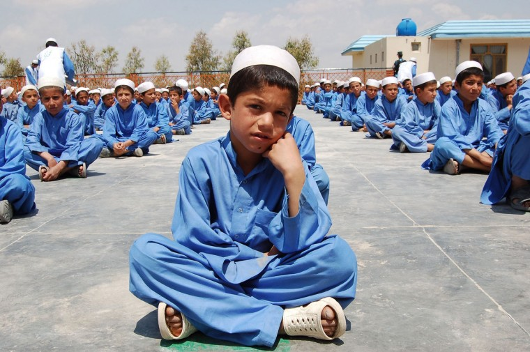 Afghan orphans sit in lines at an orphanage in Kandahar on November 19, 2012. (Mamoon DurraniMamoon Durrani/AFP/Getty Images)