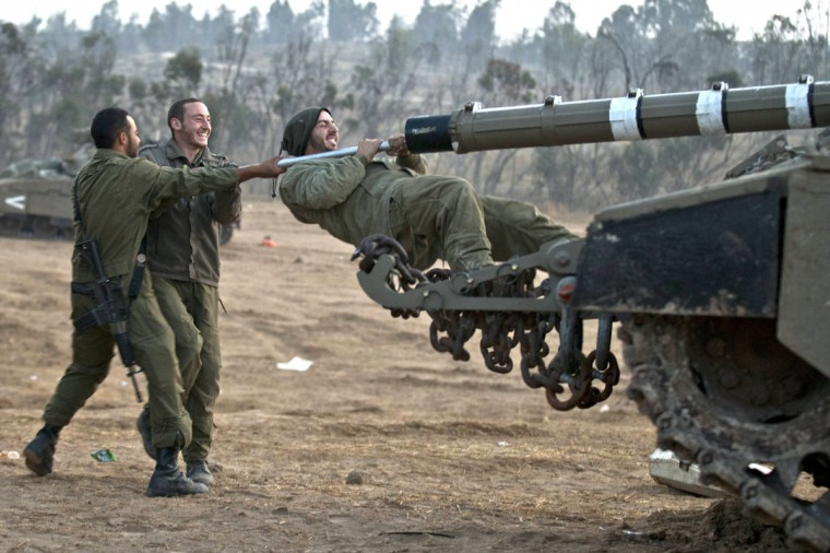 NOVEMBER 20: Israeli soldiers prepare tanks at an Israeli army deployment area near the Israel-Gaza Strip border for a potential ground operation in the Palestinian coastal enclave. (Jack Guez/AFP/Getty Images)