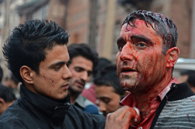 A bloodied Kashmiri Shiite Muslim looks on after performing a ritual of self-flagellation with knives during a religious procession held on the fourth day of Ashura, which remembers the slaying of the Prophet Mohammed's grandson in southern Iraq in the seventh century, in Srinagar. (Tauseef Mustafa/AFP/Getty Images)