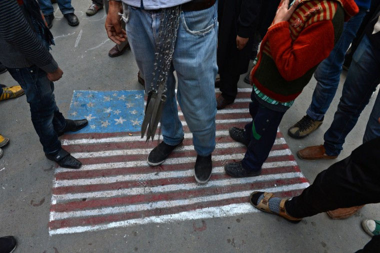 Kashmiri Shiite Muslims step on a US flag painted on the street during a religious procession held on the fourth day of Ashura, which remembers the slaying of the Prophet Mohammed's grandson in southern Iraq in the seventh century, in Srinagar. During the Shiite Muslim holy month of Muharram, large processions are formed and the devotees parade the streets holding banners and carrying models of the mausoleum of Hazrat Imam Hussain and his people, who fell at Karbala. (Tauseef Mustafa/AFP/Getty Images)