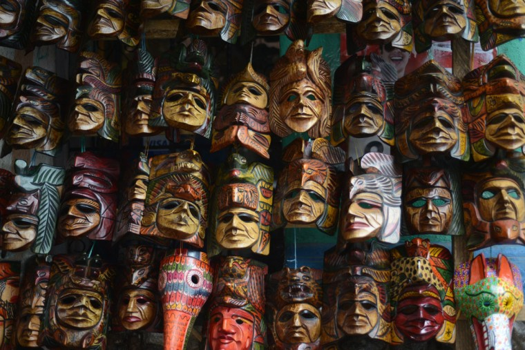 Wooden masks are offered to tourists at a handicrafts market in Chichicastenango municipality, Quiche department, 167 km west of Guatemala City. Ceremonies will be in different sites of Guatemala to celebrate the end of the Mayan cycle known as Bak'tun 13 and the start of the new Maya Era on December 21. The Mayan calendar has 18 months of 20 days each plus a sacred month, 'Wayeb,' of five days. 'B'aktun' is the larget unit in the time cycle system, and is about 400 years. The broader era spans 13 B'aktun, or about 5,200 years. (Johan Ordonez/AFP/Getty Images)