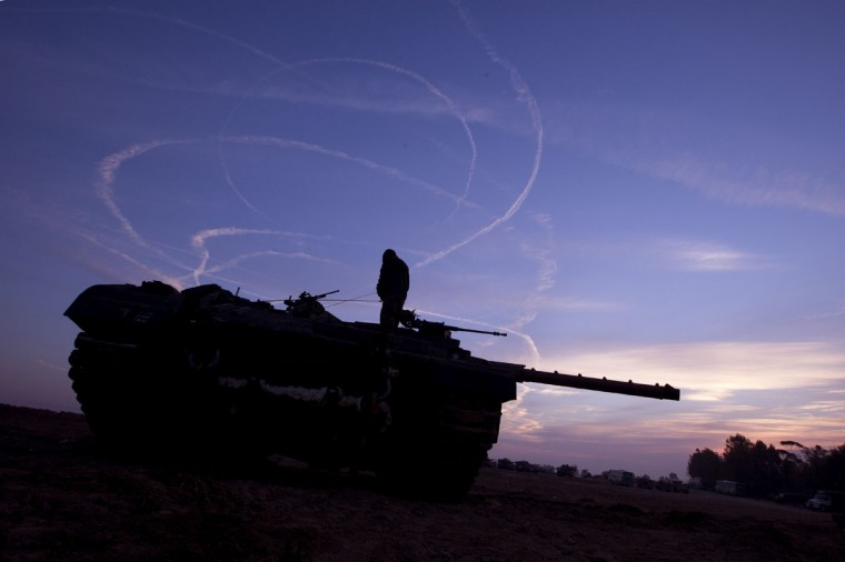 NOVEMBER 21: Israeli tanks are stationed at an Israeli army deployment area near the Israel-Gaza Strip border with smoke trail in the background. (Jack Guez/AFP/Getty Images)