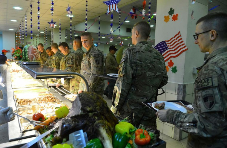 US soldiers wait in line for their Thanksgiving Day meal on the premises of the Kabul International Airport. (Shahdf Marai/AFP/Getty Images)