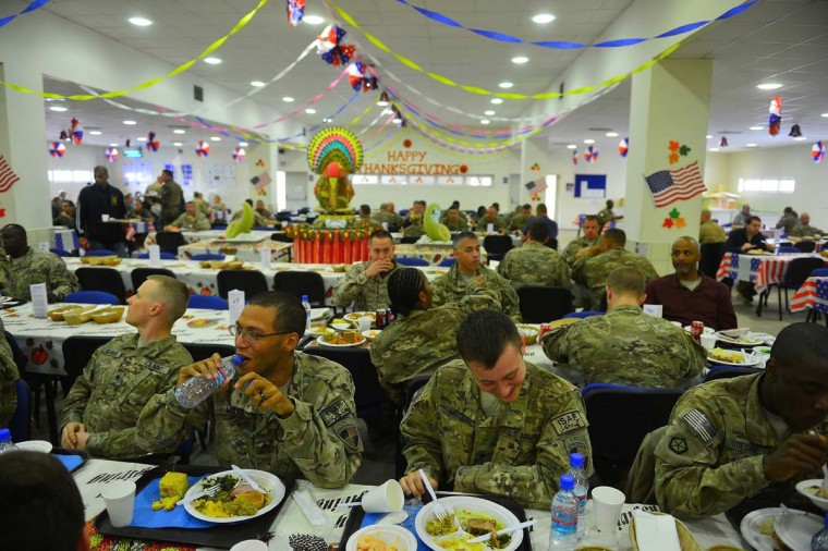 US soldiers enjoy their Thanksgiving Day meal on the premises of the Kabul International Airport. (Shah Marai/AFP/Getty Images)