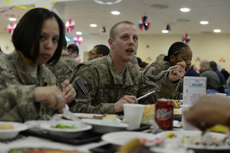 US soldiers enjoy their Thanksgiving Day meal on the premises of the Kabul International Airport. The meal was served to mark the US celebration of the Thanksgiving Day holiday. (Shah Marai/AFP/Getty Images)