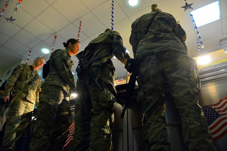 US soldiers wait in line for their Thanksgiving Day meal on the premises of the Kabul International Airport. The meal was served to mark the US celebration of the Thanksgiving Day holiday. (Shah Marai/AFP/Getty Images)