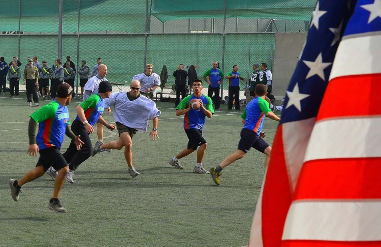 US soldiers play football during Thanksgiving at the Kabul International Airport. Festivities we held to mark the US celebration of the Thanksgiving Day holiday. (Shah Marai/AFP/Getty Images)