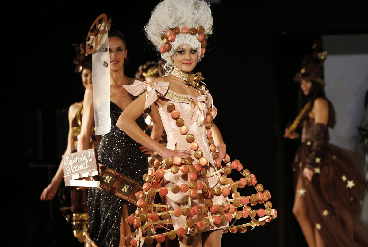 A model presents a dress made of chocolate and macaroons