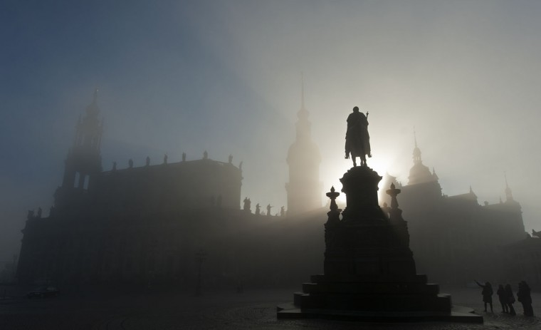 Heavy fog covers the silhouette of Dresden (L-R: the Hofkirche (Sanctissimae Trinitatis Catholic Church of the Royal Court of Saxony), the Castle and the equestrian sculpture of King John) in Dresden, eastern Germany. (Robert Michael/AFP/Getty Images)