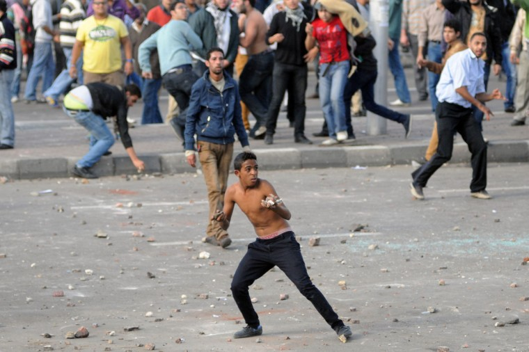 Egyptian supporters and opponents of President Mohamed Morsi clash in the Mediterranean coastal city of Alexandria on November 23, 2012. (STR/AFP/Getty Images)