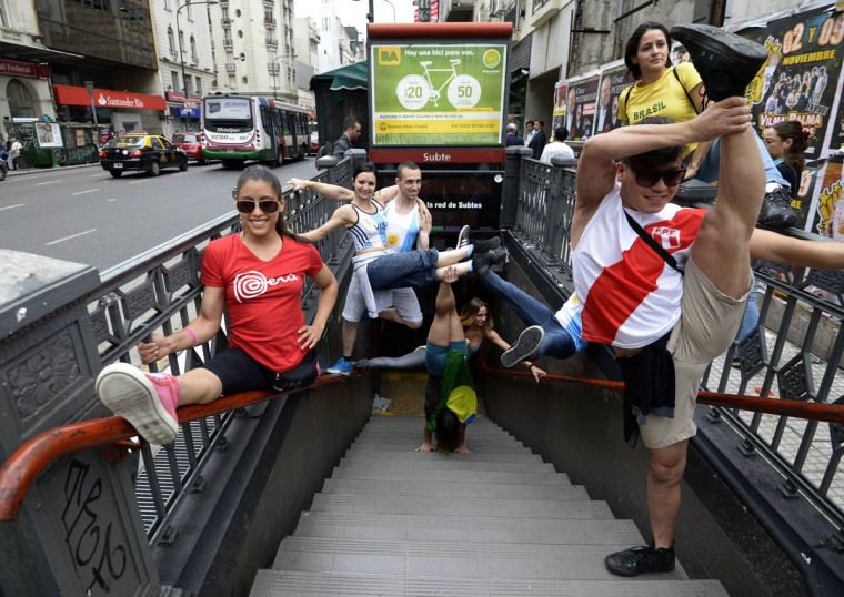 Participants in the Pole Dance Argentina 2012 and Pole Dance South America 2012 competitions perform in downtown Buenos Aires on November 23, 2012 ahead of the contest to be held on November 24 and 26 in Buenos Aires. (Juan Mabromata/AFP/Getty Images)