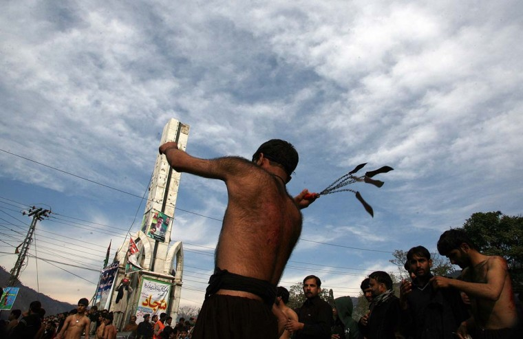 Pakistani Shi'ite Muslims flagellate themselves during a Ashura procession in Muzaffarabad on November 25, 2012. (Sajjad Qayyum/AFP/Getty Images)