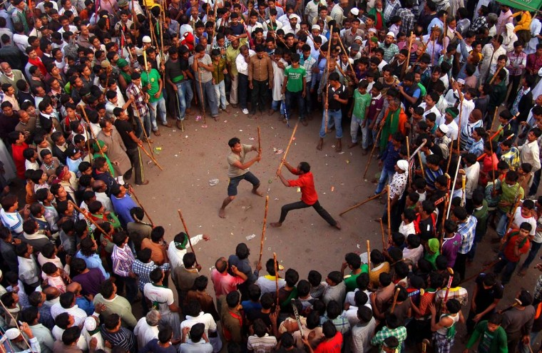 Indian Shiite Muslims participate in a mock fight during a religious procession on the tenth day of Ashura in Allahabad on November 25, 2012. During the Shiite Muslim holy month of Moharram, large processions are formed and the devotees parade the streets holding banners and carrying models of the mausoleum of Hazrat Imam Hussain and his people, who fell at Karbala. (Sanjay Kanojia/AFP/Getty Images)