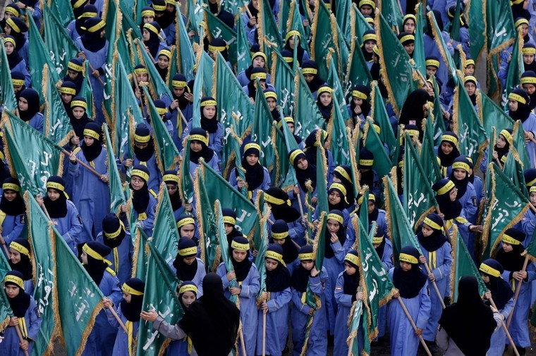 Shi'ite Muslim girls rally in the southern suburbs of the Lebanese capital Beirut, on November 25, 2012, to mark Ashura, commemorating the death of Imam Hussein, grandson of the Prophet Mohammed. (STR/AFP/Getty Images)