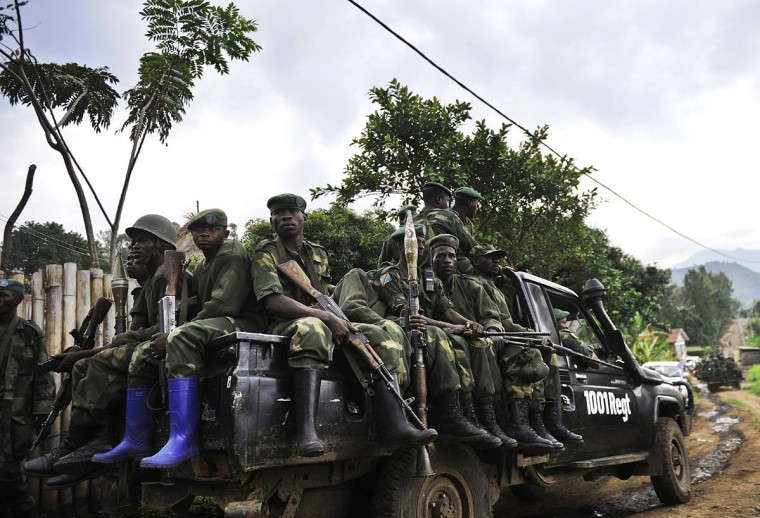 Democratic Republic of Congo government soldiers ride on the back of a truck on November 25, 2012 in Minova. Congolese rebels on Sunday rejected demands by regional governments to pull out of the eastern city of Goma to allow for peace talks aimed at preventing a wider conflict and halting a spiraling humanitarian catastrophe. (Tony Karumba/AFP/Getty Images)