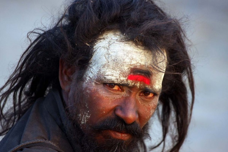 A Hindu holy man - sadhu - looks on from the banks of the Sangam, the confluence of Rivers Ganges and Yamuna and the mythical Saraswati in Allahabad on November 26, 2012. (Sanjay Kanojia/AFP/Getty Images)