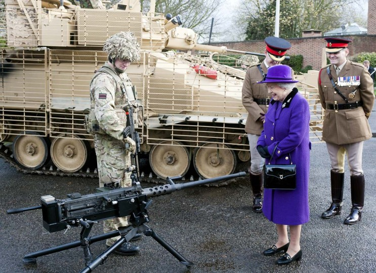 Queen Elizabeth II inspects weaponry as she meets members of the Household Cavalry during her visit to Combermere Barracks in Windsor, on November 26, 2012. (David Parker/AFP/Getty Images)