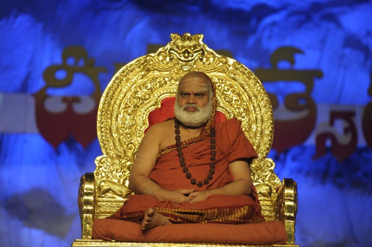 Shri Chandrasekara Bharathi Theertha Swamigal of Sringeri graces an event as Indian Hindu devotees perform a ritual by lighting diyas - earthen lamps - on the occasion of Karthika month in Hyderabad on November 26, 2012. (Noah Seela/AFP/Getty Images)