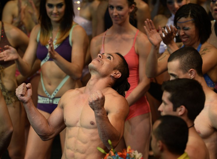 Brazilian pole dancer Carlos Franca (C) celebrates after winning the Mr Pole Dance South America 2012 competition in Buenos Aires on November 26, 2012. (Juan Mabromata/AFP/Getty Images)