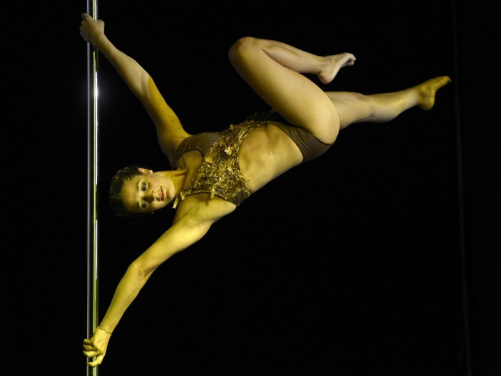 Argentine pole dancer Maria Rame competes to win the Miss Pole Dance Argentina 2012 and finishing in second place in the Miss Pole Dance South America competition in Buenos Aires on November 26, 2012. (Juan Mabromata/AFP/Getty Images)