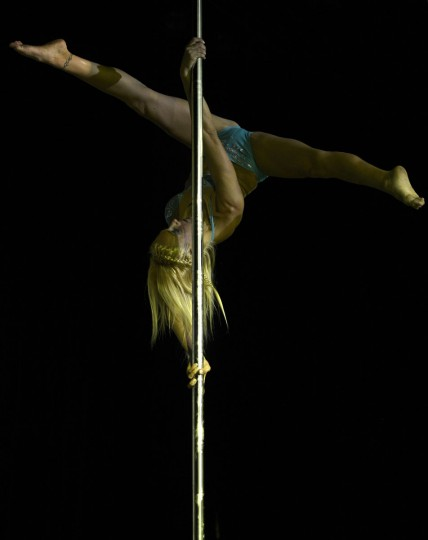 Argentine pole dancer Daniela Schmoll competes in the Miss Pole Dance Argentina 2012 competition in Buenos Aires on November 26, 2012. Schmoll finished in second place. (Juan Mabromata/AFP/Getty Images)