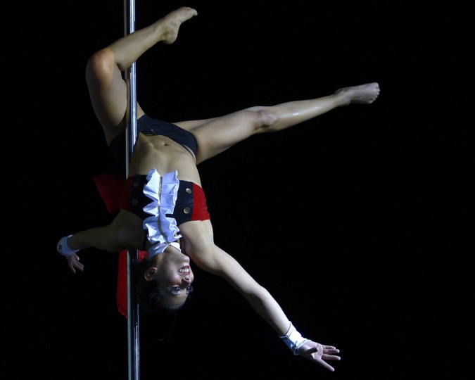 Peruvian pole dancer Ximena Ribero competes to finish in third place in the Miss Pole Dance South America 2012 competition as well as win the Best Artistic Performance trophy. (Juan Mabromata/AFP/Getty Images)