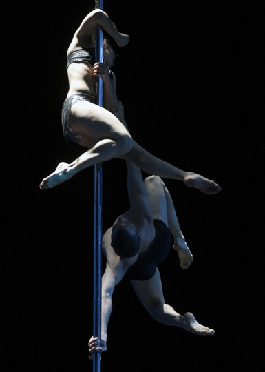 Argentine pole dancers Belen Serra and Joaquin Dazzotti compete to win first place in the Pole Dance South America 2012 competition in Buenos Aires on November 26, 2012. (Juan Mabromata/AFP/Getty Images)