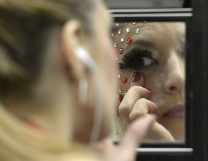 A pole dancer puts on make-up on backstage during the Miss Pole Dance Argentina and South America 2012 competition in Buenos Aires on November 26, 2012. (Juan Mabromata/AFP/Getty Images)